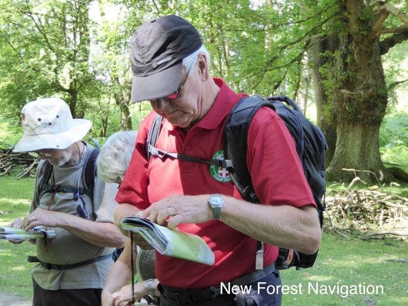 beginner checking path direction with a compass on a nnas bronze course