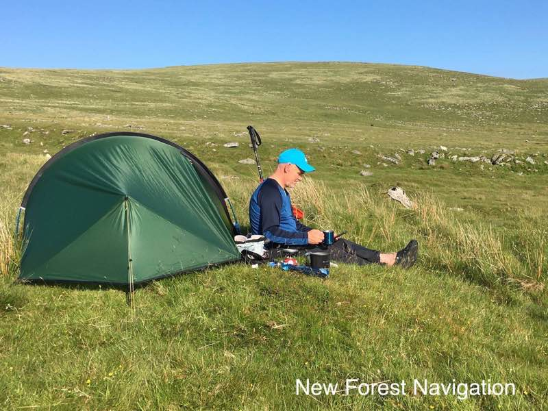 Relaxing after a fun day with a cup of tea on a dartmoor wild camping trip