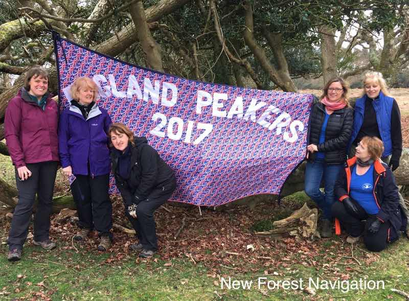 English peakers group with a banner displayed during a bespoke map outdoor skills course