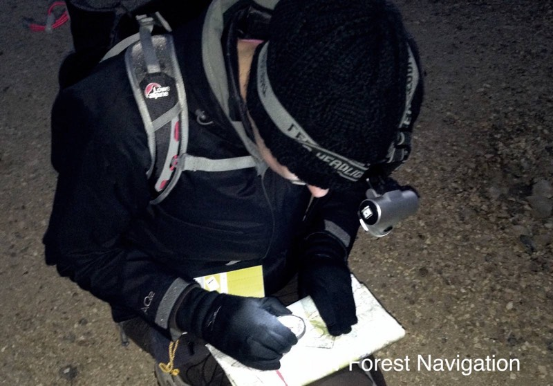 checking the path carefully at night with a compass bearing