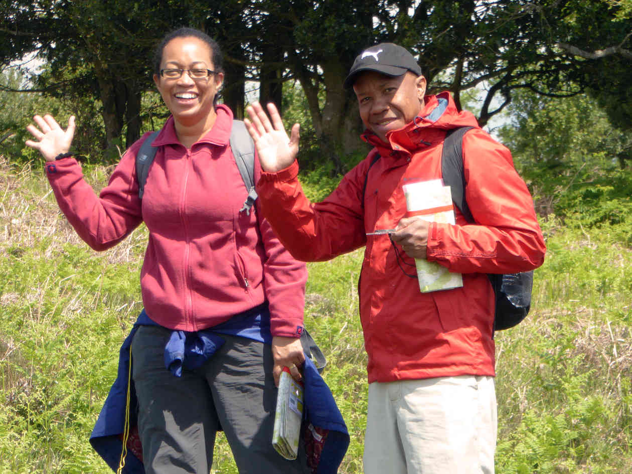 couple wave a smile at the camera on a map reading course