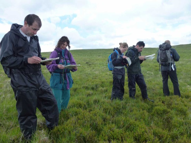 novice map readers learning mountain navigation and hills skills in brecon beacons wales