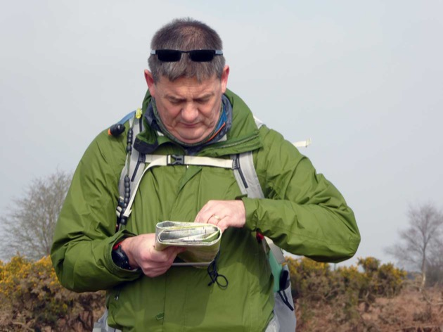 silver National Navigation Award Scheme participant uses a compass on assessment