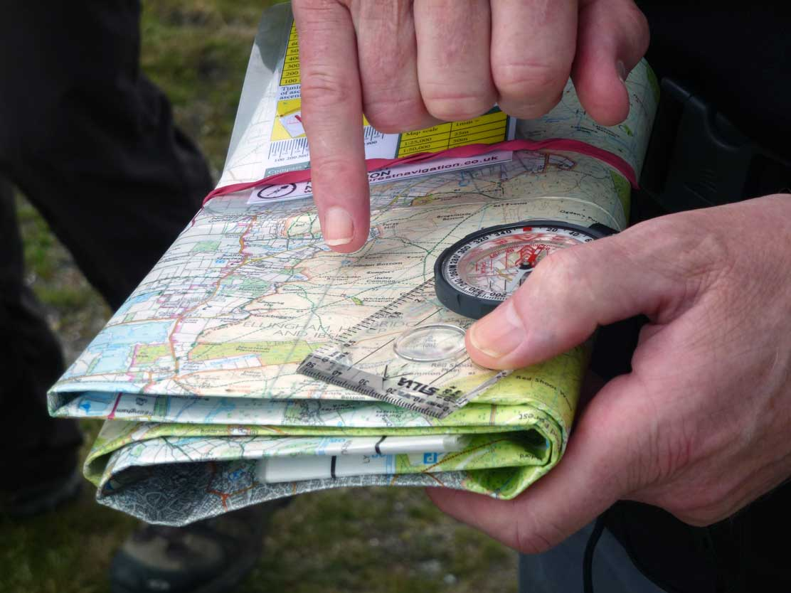 close up of someone pointing at a new forest map