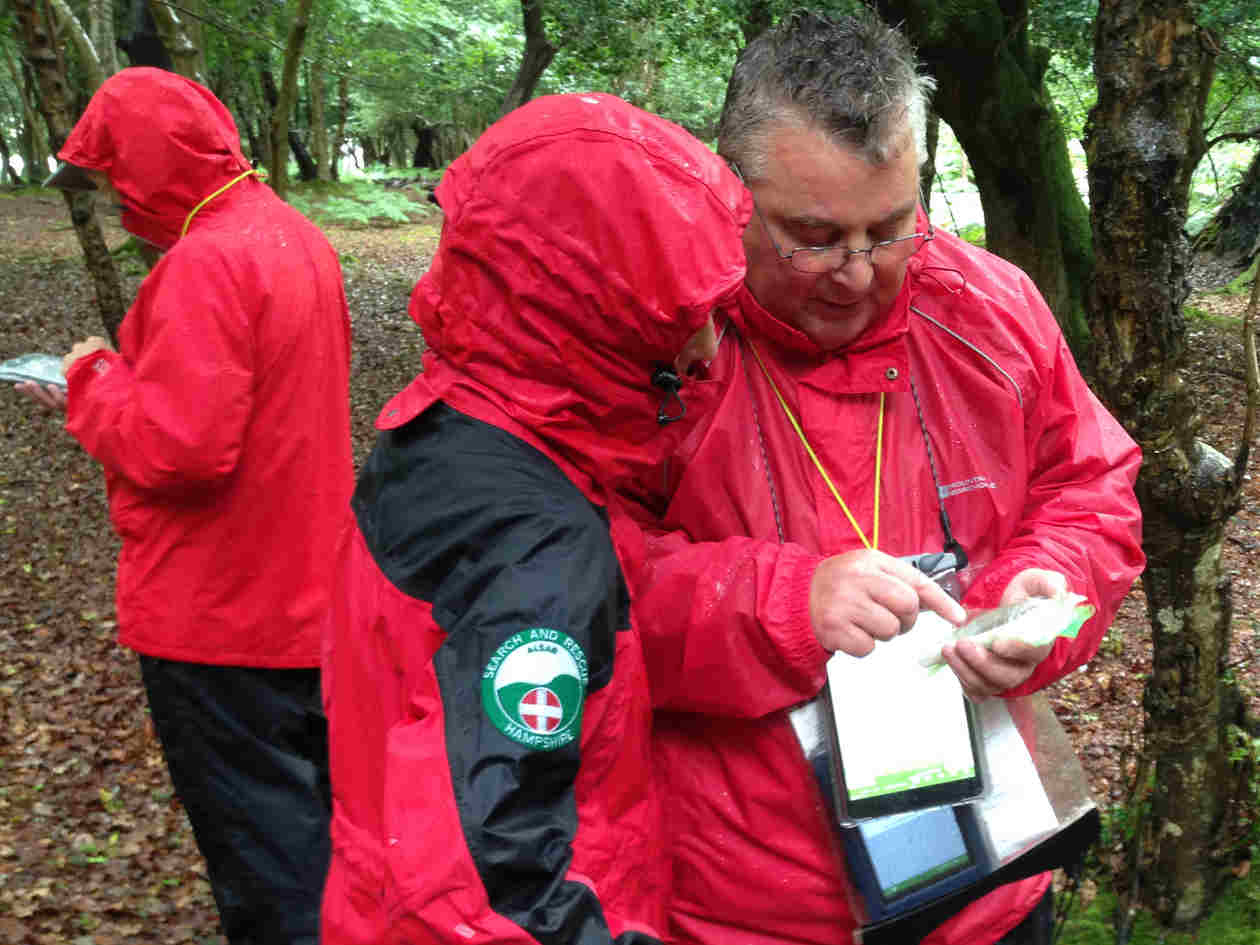man trying out different devices on a wet viewranger training day